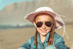 Little girl in a hat on the  beach Royalty Free Stock Photo