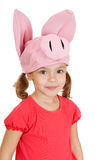 Little girl in hat cheerful pig. Stock Photography