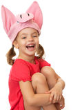 Little girl in hat cheerful pig. stock images