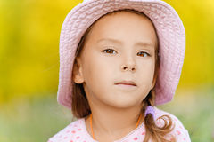 Little girl in hat close up Stock Images