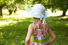 The little girl in a hat and dress Stock Image