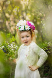 The little girl in a hat from flowers in the wood Stock Photography