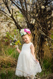 The little girl in a hat from flowers in the wood Royalty Free Stock Photos