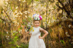 The little girl in a hat from flowers in the wood Royalty Free Stock Photography