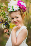 The little girl in a hat from flowers in the wood Royalty Free Stock Images