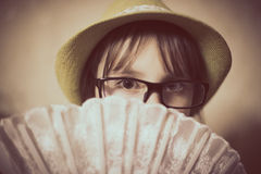 Little girl in hat and glasses. Royalty Free Stock Images