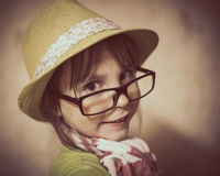 Little girl in hat and glasses. Stock Photos