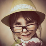 Little girl in hat and glasses. Royalty Free Stock Photos