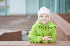 Little girl in hat and jacket Stock Photo