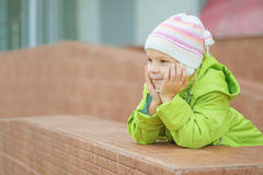 Little girl in hat and jacket Stock Images