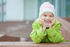 Little girl in hat and jacket Royalty Free Stock Images