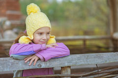 Little girl in hat and jacket Stock Photography