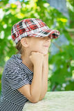 Little girl in hat Stock Photos