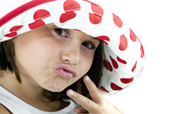 Little Girl with Hat and Peace Sign Stock Photo