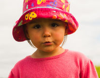 Little girl in a hat. Photo took in New Zealand, photo is usable on picture post card Stock Photos