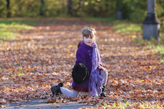 Little girl in hat poses with scarf Stock Images