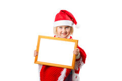 Little girl in hat Santa Claus holding frame with a white backgr Royalty Free Stock Images