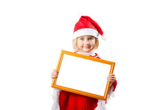 Little girl in hat Santa Claus holding frame with a white backgr Royalty Free Stock Photo