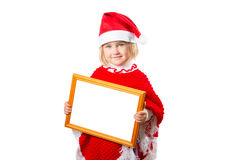 Little girl in hat Santa Claus holding frame with a white backgr Stock Images