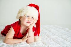 Little Girl in Hat Santa royalty free stock photo