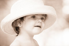 Little girl with hat Stock Images