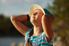Little girl in a hat squinting from the sun Royalty Free Stock Photography