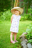 Little girl in a  hat Stock Photography