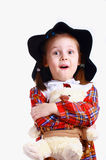 A little girl in the hat with a teddy bear Royalty Free Stock Images