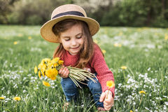 Little girl in a hat walking royalty free stock image