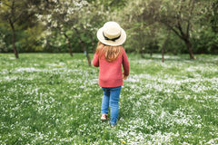 Little girl in a hat walking stock images
