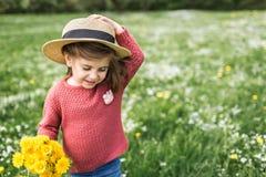 Little girl in a hat walking stock photos