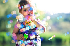 Little girl have fun. At summer park Stock Images