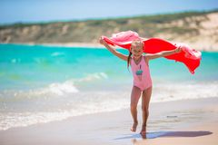 Little girl have fun with beach towel during Royalty Free Stock Images