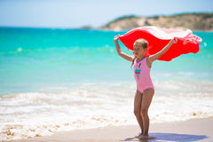 Little girl have fun with beach towel during Royalty Free Stock Photography