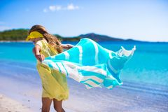Little girl have fun with beach towel during Royalty Free Stock Photo