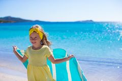 Little girl have fun with beach towel during Stock Photo