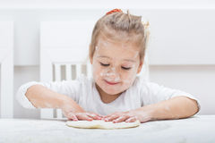 Little Girl Have Fun With Kneading Dough Royalty Free Stock Photos