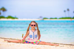 Little girl have fun with lollipop on the beach Royalty Free Stock Photo