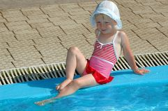The little girl have fun at pool Royalty Free Stock Photos