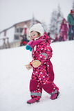 Little girl have fun at snowy winter day Royalty Free Stock Photos