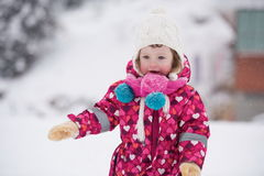 Little girl have fun at snowy winter day Royalty Free Stock Image