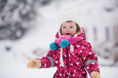 Little girl have fun at snowy winter day Stock Photo