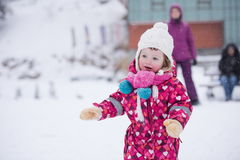 Little girl have fun at snowy winter day Royalty Free Stock Images