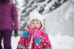 Little girl have fun at snowy winter day Royalty Free Stock Photo