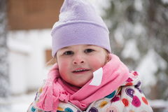 Little girl have fun at snowy winter day Stock Photos