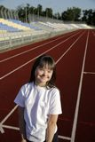 Little girl have fun on the stadium royalty free stock images