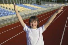 Little girl have fun on the stadium stock photos