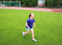 Little girl have fun on stadium Royalty Free Stock Photography