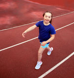 Little girl have fun on stadium Royalty Free Stock Image