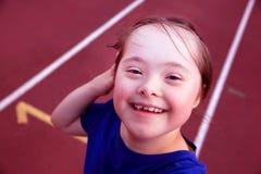 Little girl have fun on stadium Stock Image